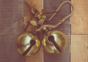 Christmas Sleigh bells on wooden background