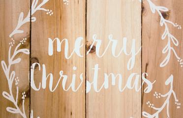 Merry Christmas written on wodden planks background