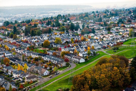 Seattle Urban Sprawl with colorful trees in autumn - aerial