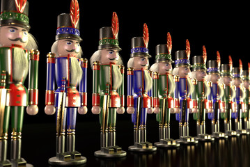 Nutcracker Lineup A line of handsome green and blue Nutcrackers. Semi isolated on black.