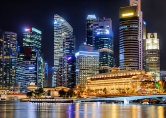 Night view of skyscrapers and old colonial building in Singapore