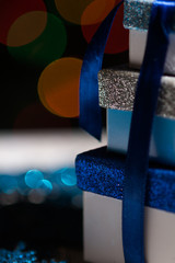 Close up of wrapped gifts with bokeh background