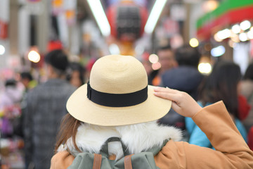 Tourist is walking in Kuromon market in Osaka, Japan.