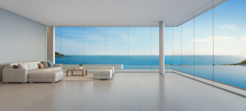 Large sofa on wooden floor near glass window and swimming pool with terrace at penthouse apartment, Lounge in sea view living room of modern luxury beach house or hotel - Home interior 3d illustration