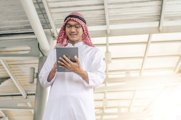 A handsome arab business man hold and browsing a digital tablet