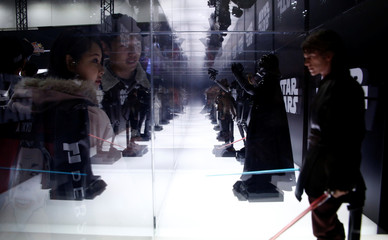 Visitors look at figures from the Star Wars movies at Tokyo Comic Con at Makuhari Messe in Chiba