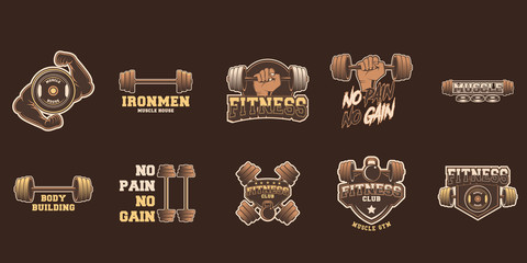 Set of gym logos, labels and slogans in vintage style