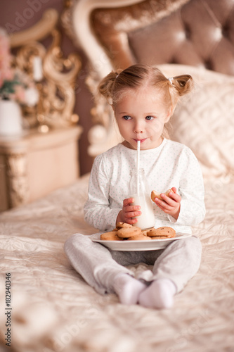 Cute Baby Girl 3 4 Year Old Drinking Milk And Eating Cookies In Bed