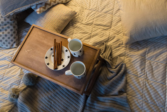 Couple of cup on vintage tray in bed. Flat lay