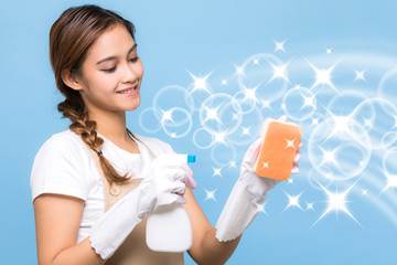 Young woman holding a cleanser spray.