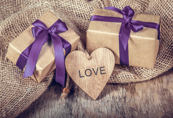 Wooden heart and gift box with ribbon. Romantic decoration for Valentine's Day. Symbol of love.