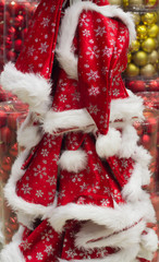 red Santa hats with snowflakes on the rack on market sell, new year and Christmas holidays