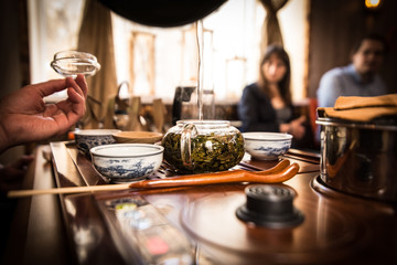 Tea ceremony against the background of blurry people