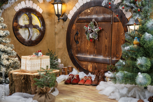 doors to the hobbit gnome house with christmas decorations and shoes