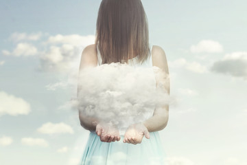 woman resembling an angel guards a small cloud in her hands