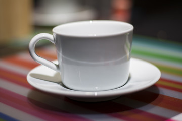 white cup of coffee on table in cafe ,Morning light