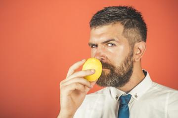 Man with long beard smell lemon.