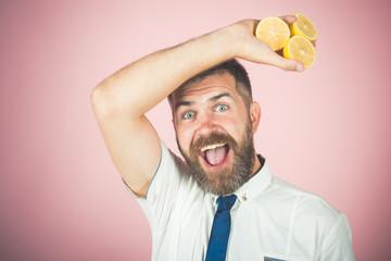 happy man with long beard hold lemon.