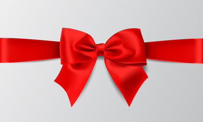 Realistic red bow isolated on white background