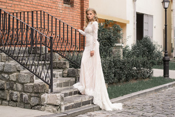 Bride thinking about happy future near modern building