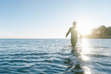 Diver entering the sea