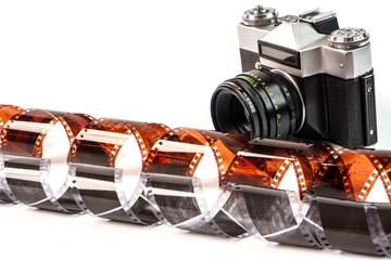 Retro film photo camera isolated on white background. Old analog