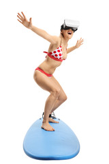 Young woman with a VR headset surfing