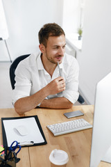 Young Business Man Working On Computer In Office.