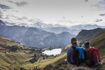 Germany, Bavaria, Oberstdorf, two hikers sitting in alpine scenery