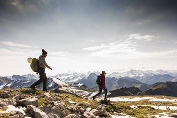 Germany, Bavaria, Oberstdorf, two hikers walking in alpine scenery