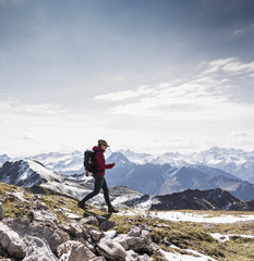 Germany, Bavaria, Oberstdorf, hiker walking in alpine scenery