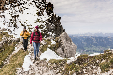 Germany, Bavaria, Oberstdorf, two hikers walking in alpine scenery