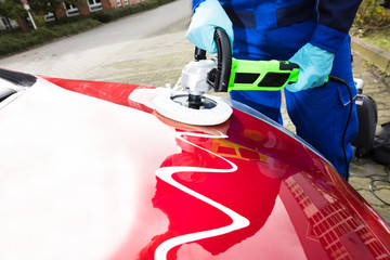 Person's Hand Polishing Car Hood