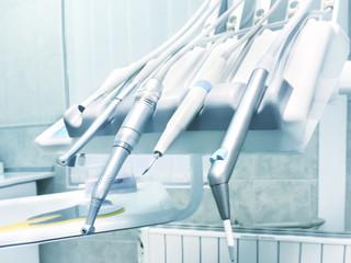 Dental drills, instruments and tools in dentists office. Closeup macro shot