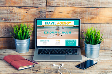 Travel agency website in a laptop screen. Escape concept.