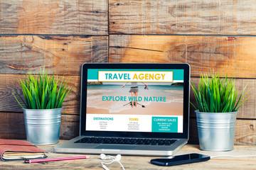 Travel Agency on line website in a laptop screen.
