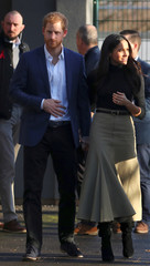 Britain's Prince Harry and his fiancee Meghan Markle leave after visiting a school in Nottingham