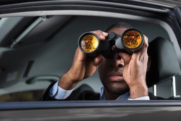 African Man Looking Through Binocular
