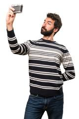 Man with beard holding a camera