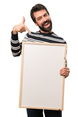 Happy Man with beard holding an empty placard