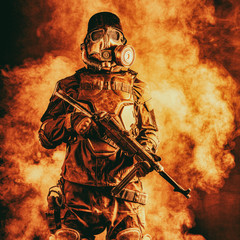 Futuristic nazi soldier in fire and smoke gas mask and steel helmet with schmeisser handgun