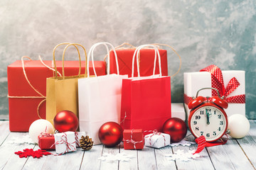 Christmas background with gift boxes and shopping bags. Christmas sale concept.
