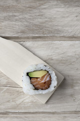 california roll in a wooden pallette