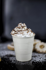 Hot chocolate with cookies on dark background