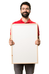 Happy Handsome man holding an empty placard