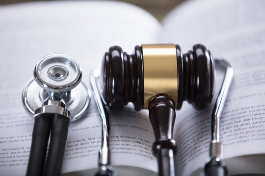 Close-up Of Stethoscope And Gavel