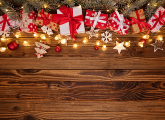 Christmas background with gifts and wooden decorations