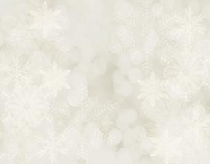 Białe płatki śniegu na jasnym kremowym tle.