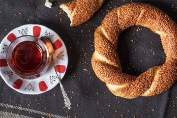 Turkish bagel with tea on cloth