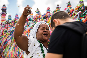 Tourist with candomble group wearing traditional clothes at Bonfim Church in Salvador, Bahia, Brazil